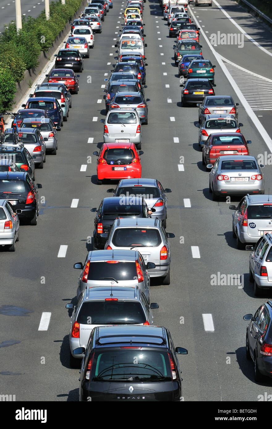 Cars queueing in highway lanes during traffic jam on motorway during summer holidays, Belgium - Stock Image