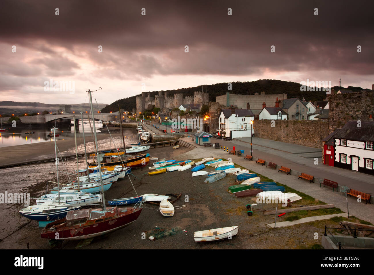 Harbour scene at Conwy in North Wales before the morning light. - Stock Image