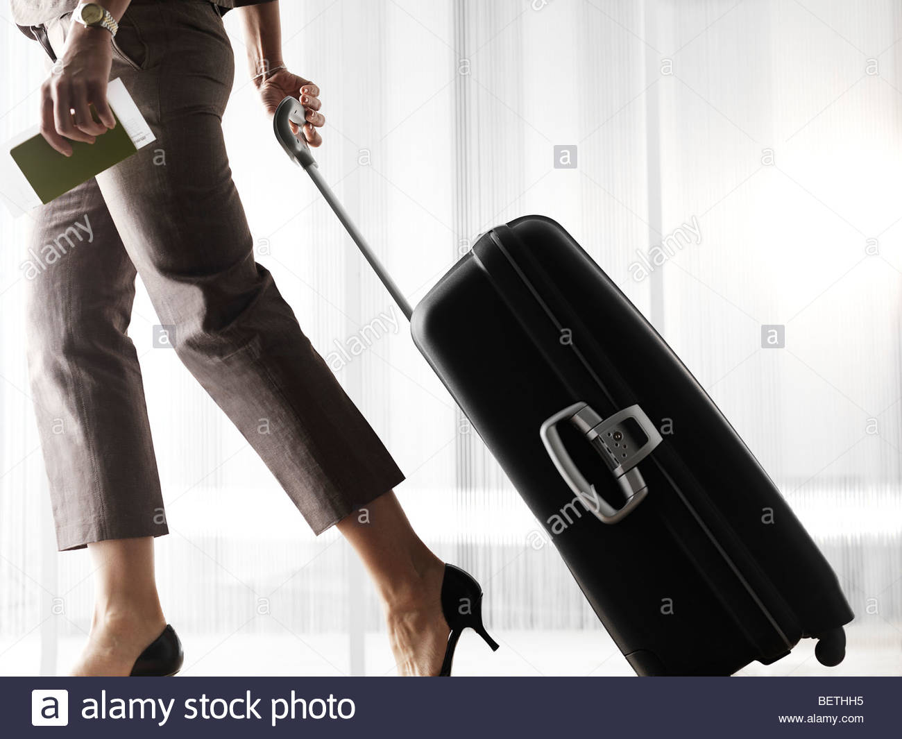 businesswoman in airport - Stock Image