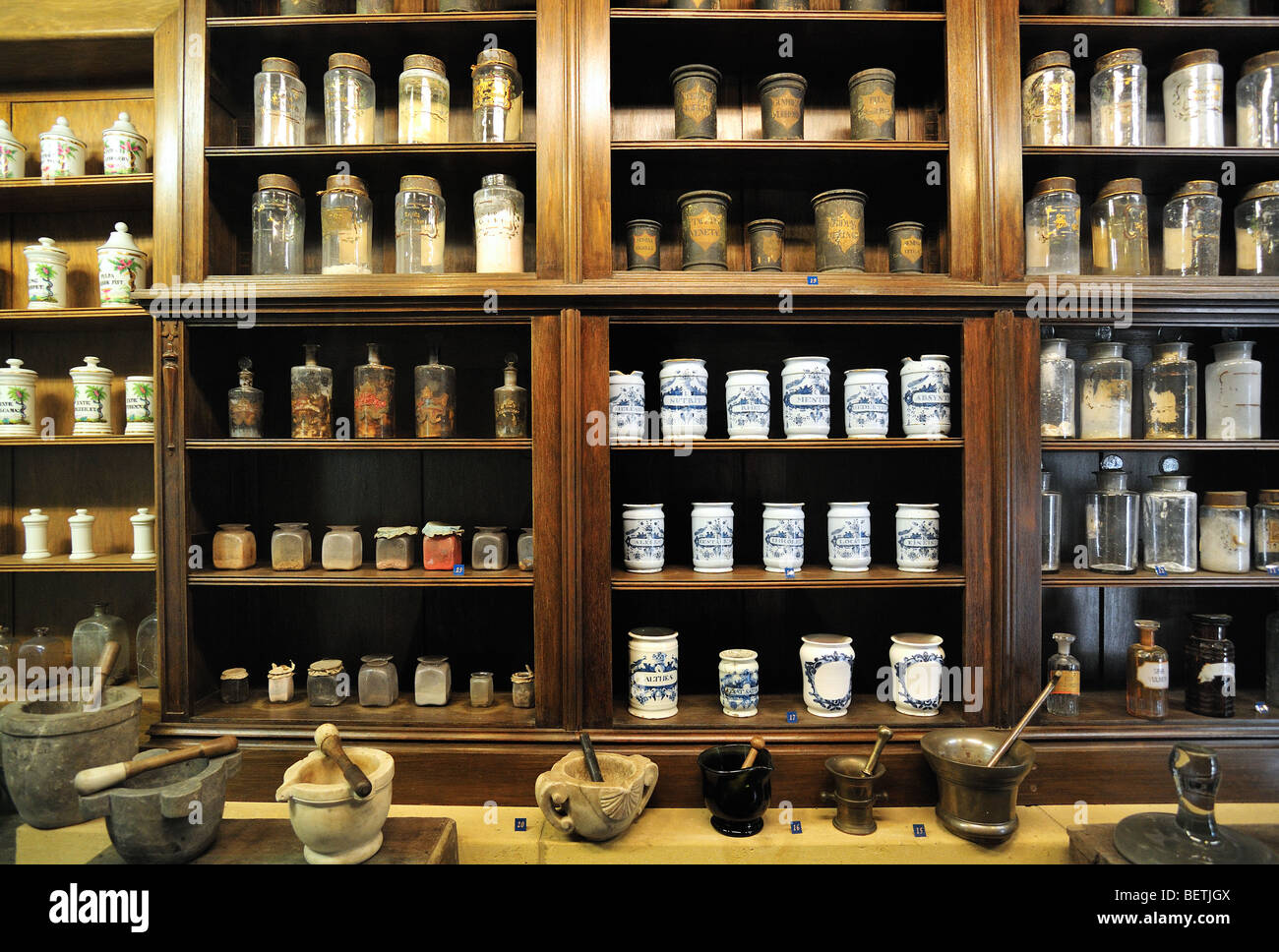 Apothecary cabinet of old pharmacy showing pots and jars with medicines in the Orval Abbey / Abbaye Notre-Dame d'Orval, - Stock Image