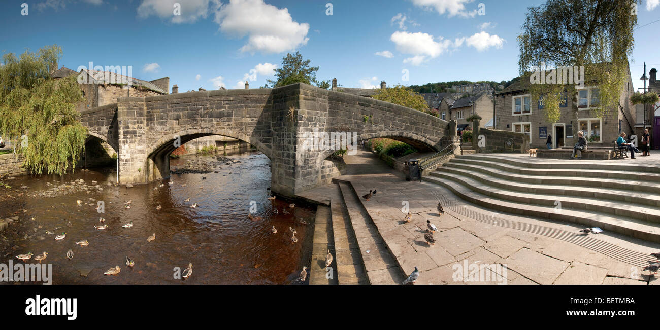 The Old Packhorse Bridge in the Yorkshire town of Hebden Bridge on the River Hebden. - Stock Image