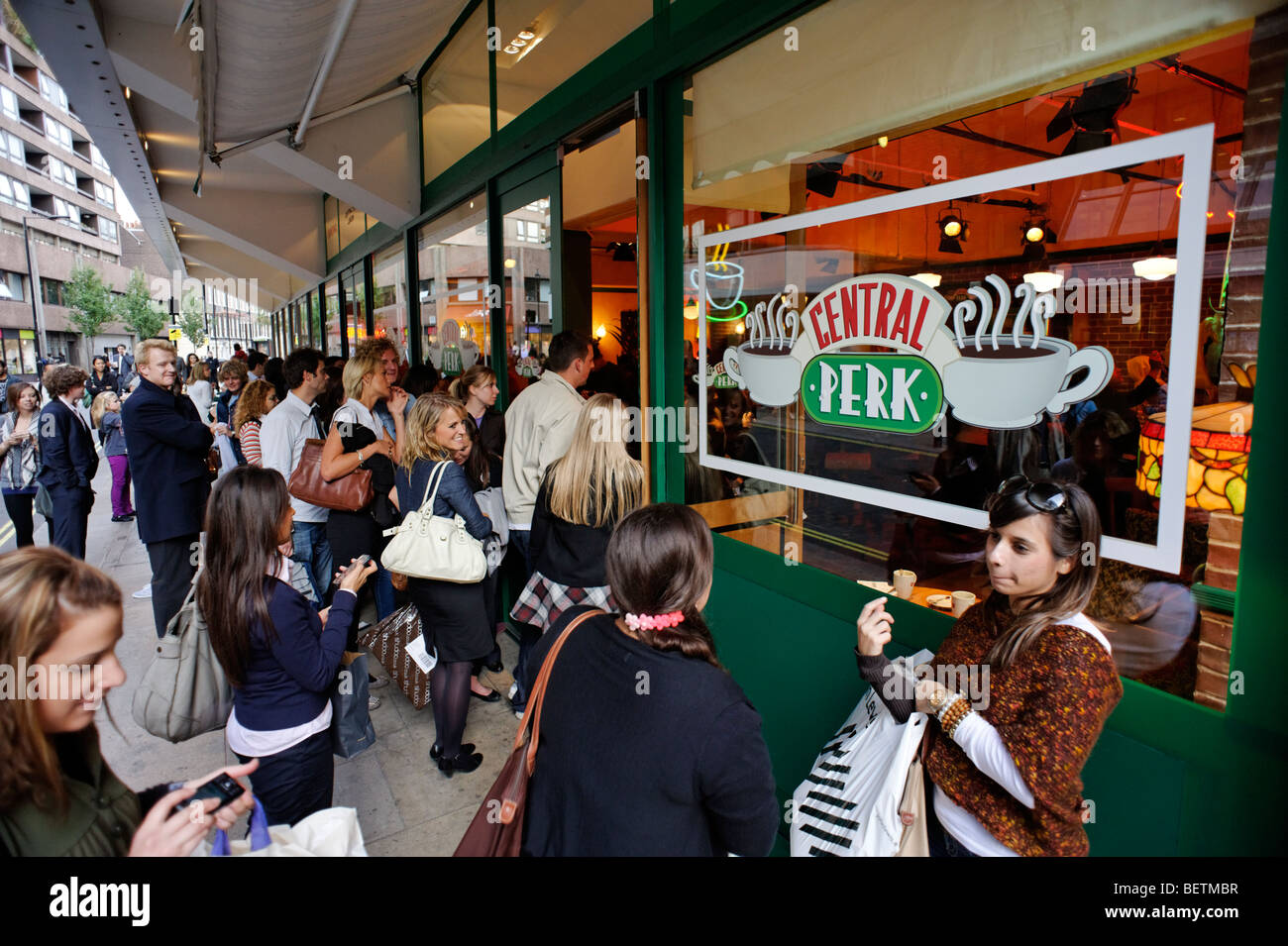 Fans of TV series 'Friends' outside mock up of Central Perk cafe. London. Britain. UK - Stock Image