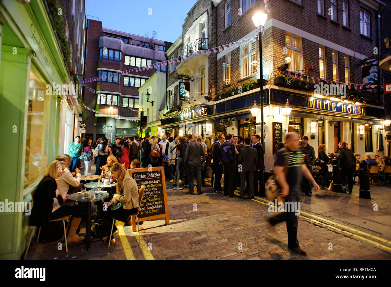 People drinking outside the White Horse pub. Soho. London. Britain. UK - Stock Image