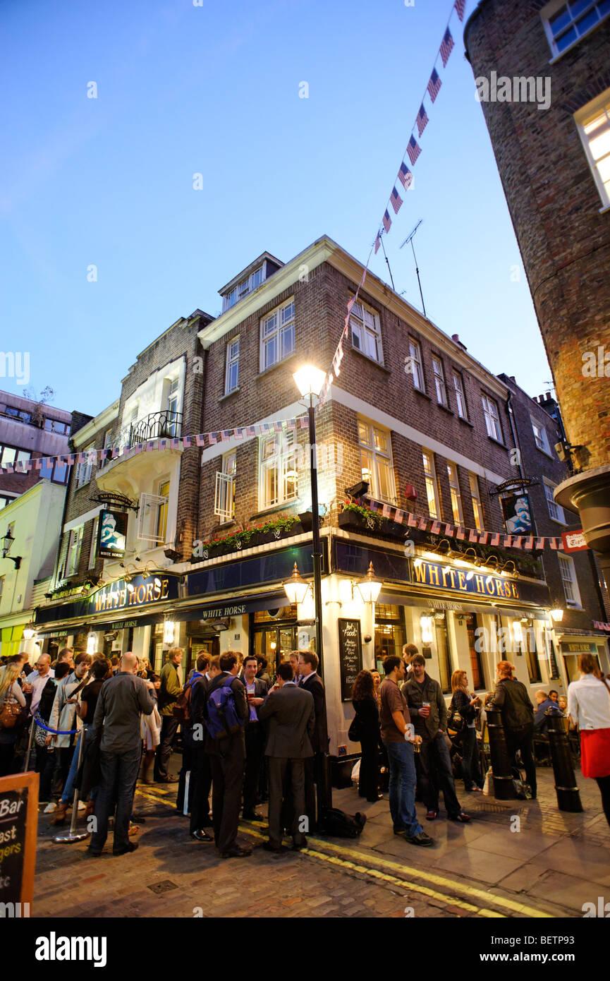 People drinking outside the White Horse pub. Soho. London. Britain. UK - Stock Image