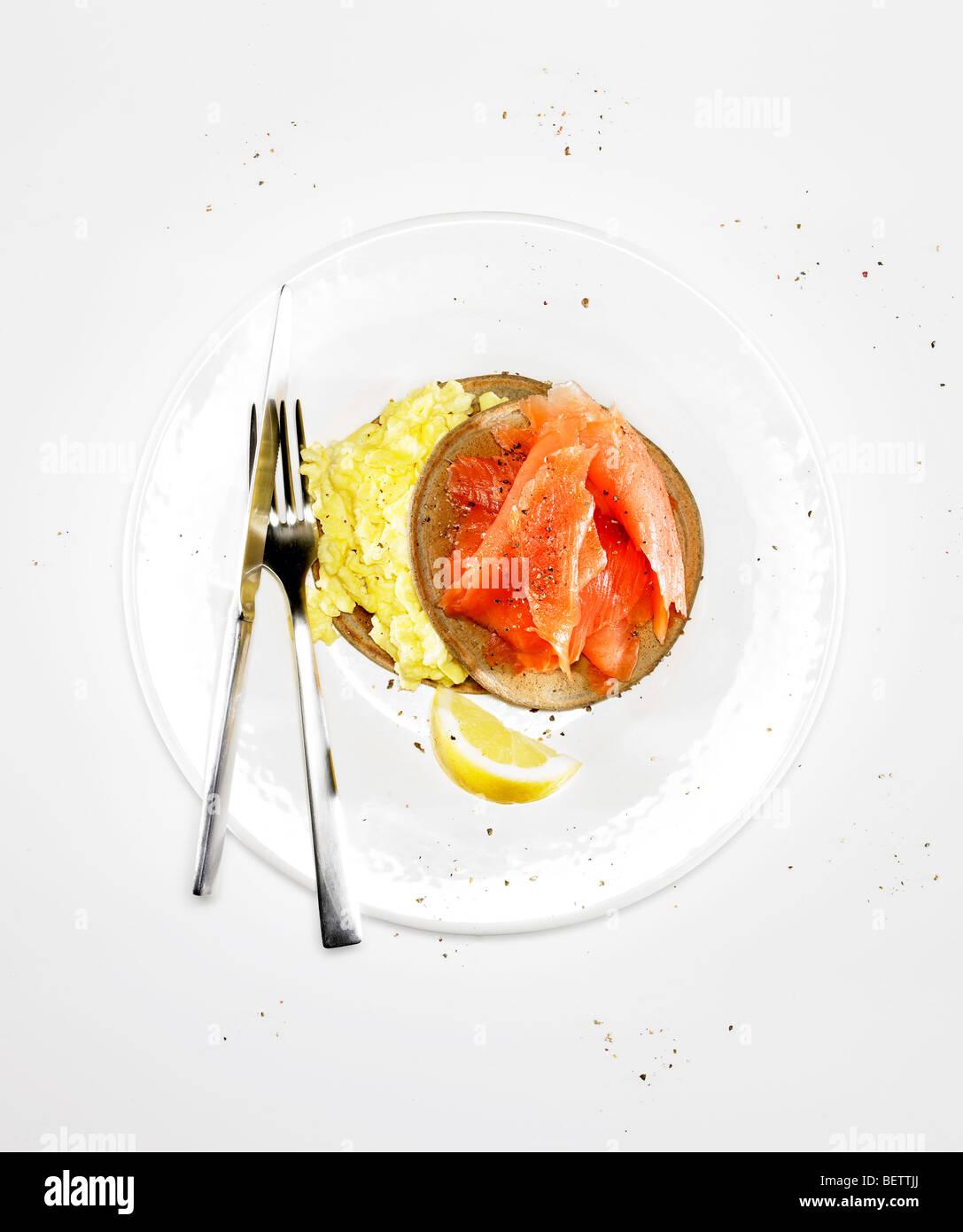 Pancake wraps with eggs and smoked salmon. - Stock Image
