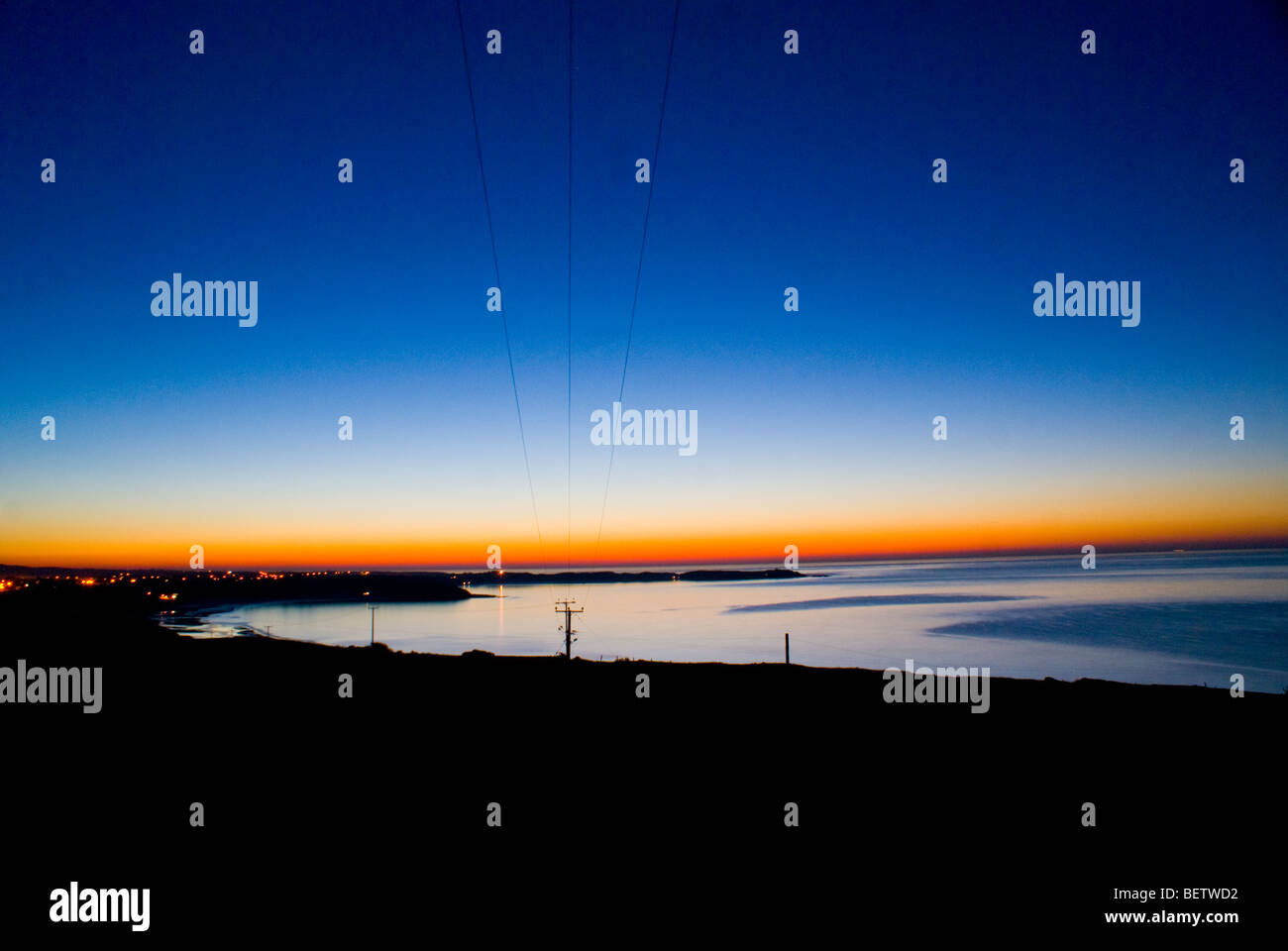 Vibrant lowlight sunset of Pwhelli harbour, wales - Stock Image