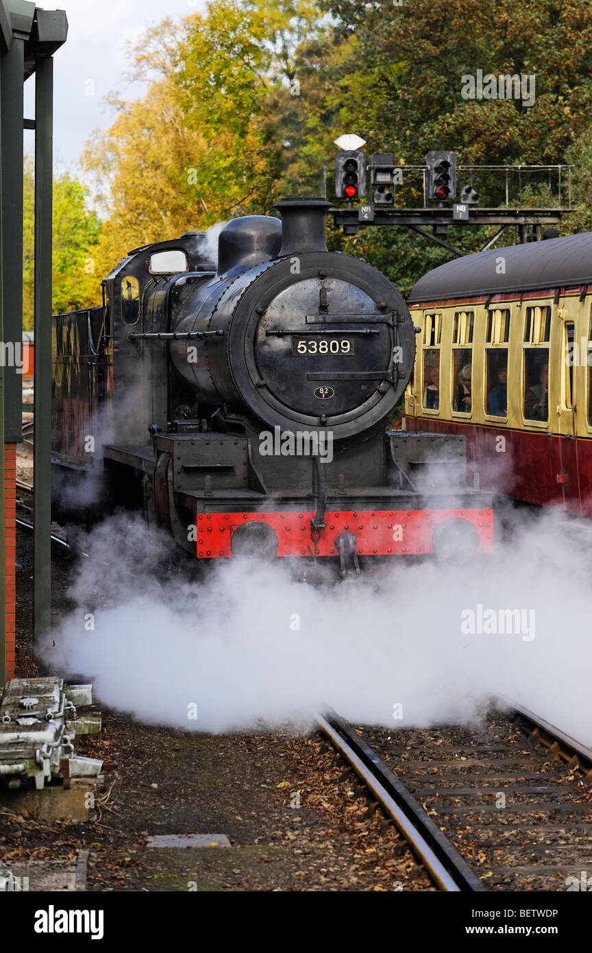 Steam locomotive 53809 letting off steam at Pickering Raiway station during the Pickering Wartime Weekend event - Stock Image