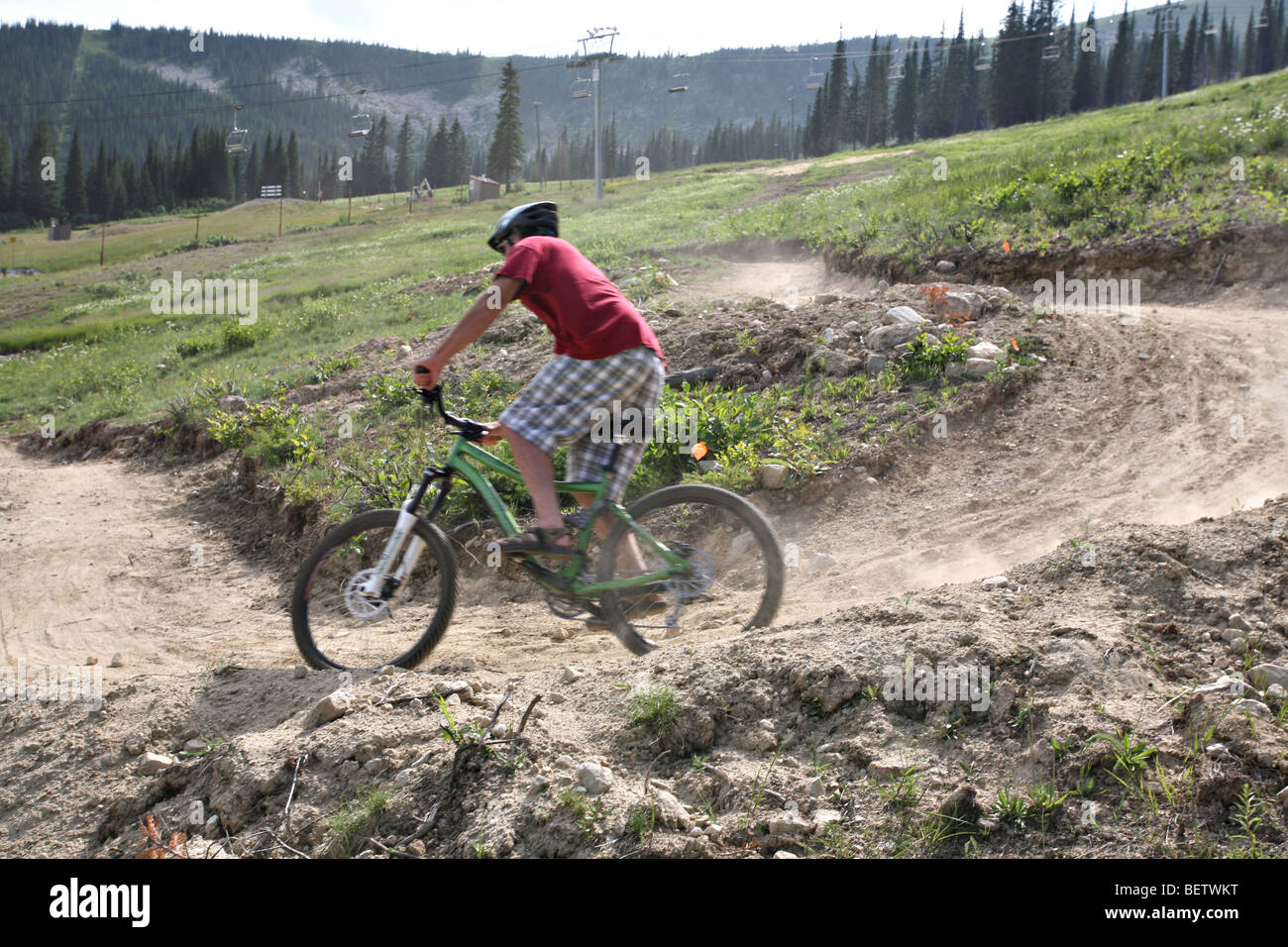 Mountain biker in motion heading down the course during the summer at Schweitzer Mountain Ski Resort, Sandpoint, - Stock Image