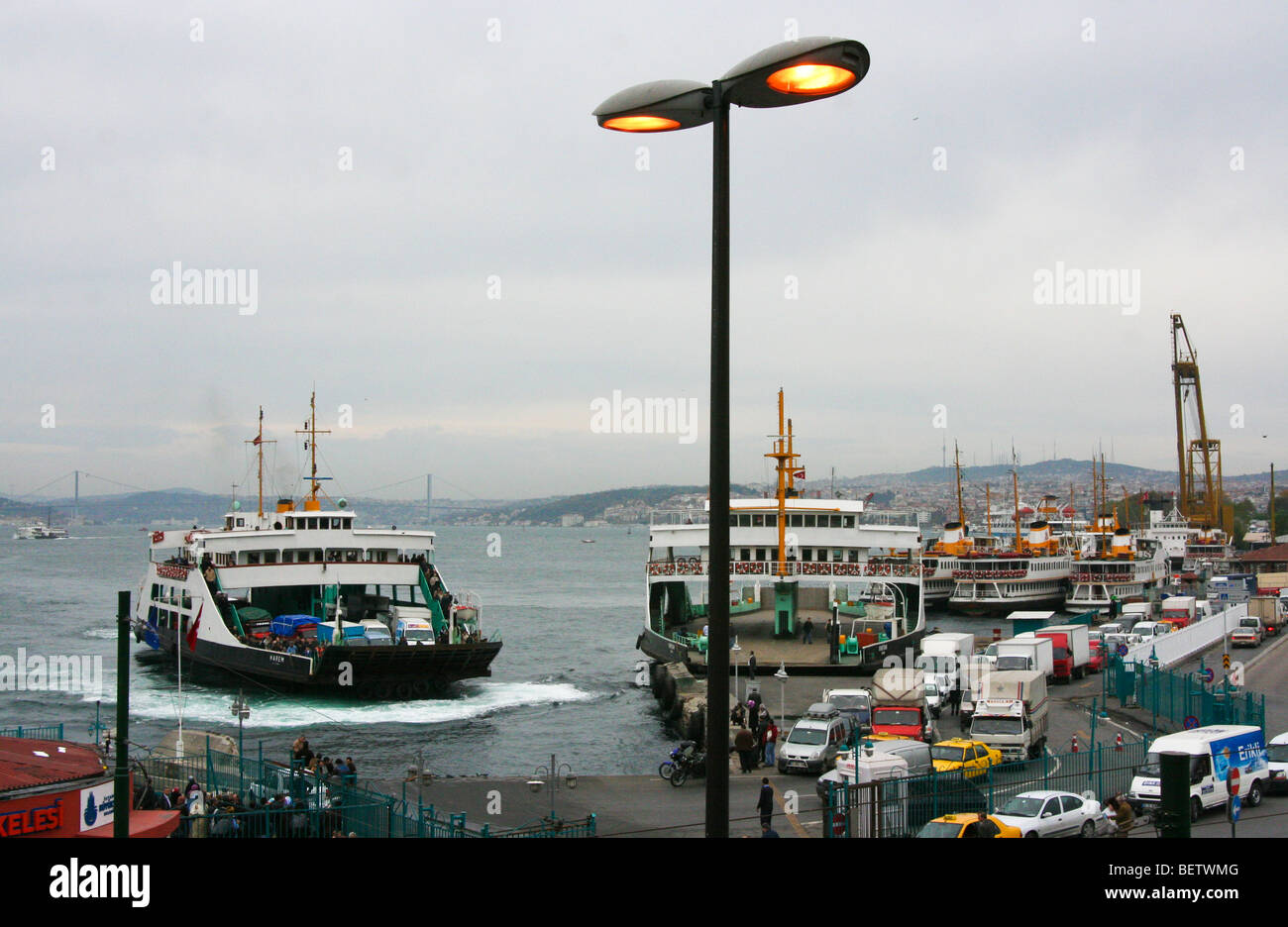 View over the Eminonu pier in Istanbul with car transporting ferries in the dock. - Stock Image
