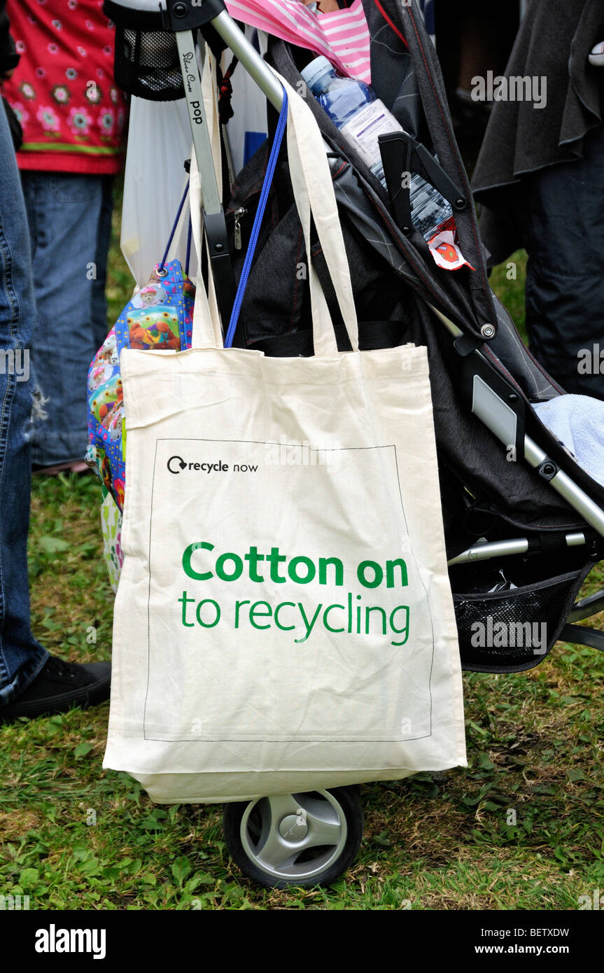 Reusable cotton bag hanging from pram - Stock Image