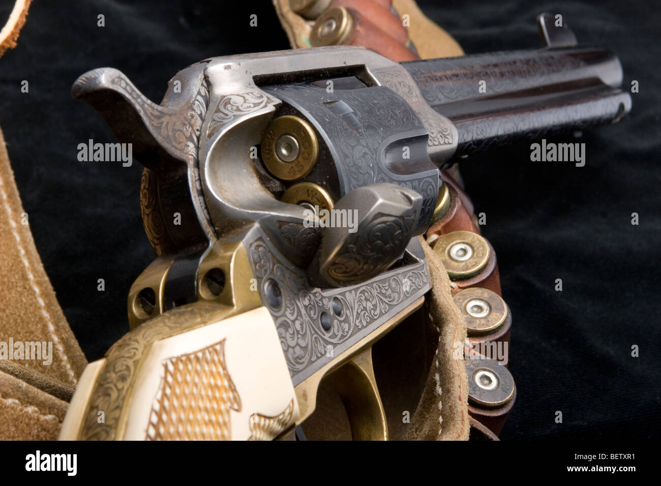 Cowboy & movie actor John Wayne's Colt 45 sixshooter and bullets. - Stock Image