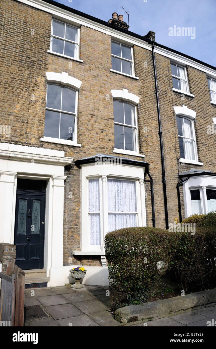 Mid Victorian three story terraced brick built house, Holloway, Islington London England UK - Stock Image