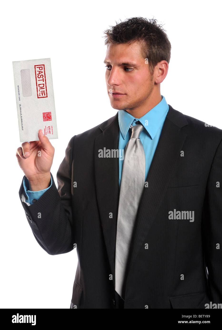 Businessman holding past due envelope isolated over white background - Stock Image