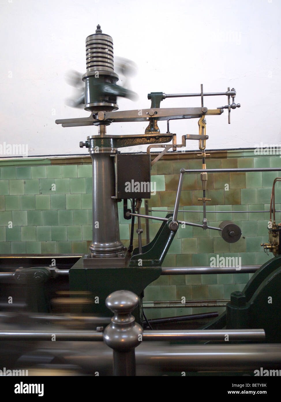 The steam engine powering the looms of the Queen Street MIll Textile Museum in Burnley in Lancashire,the steam governor - Stock Image