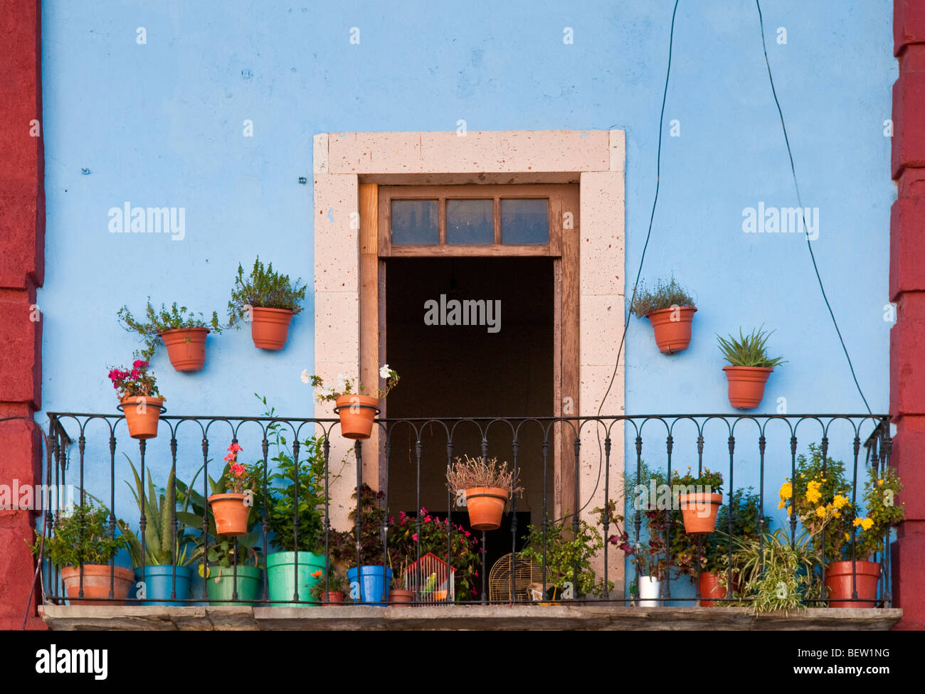 Flower pots on balcony of apartment in downtown Guanajuato, Mexico. - Stock Image