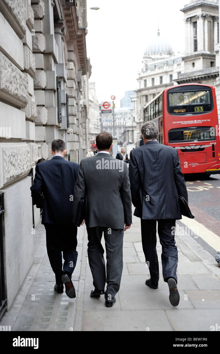 Office workers walking along King William St towards Bank. City of London. Britain. UK - Stock Image