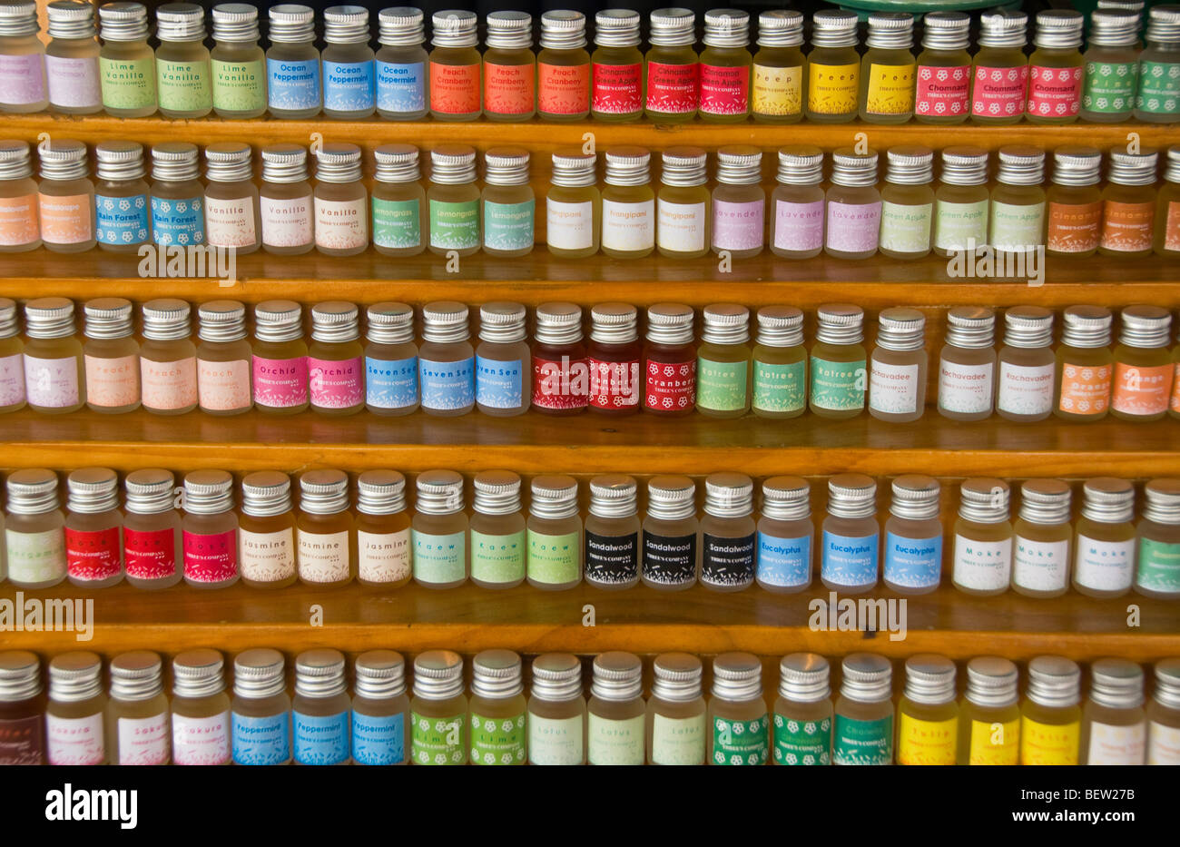 jars of herbal oils for sale at the Chatuchak Weekend Market in Bangkok Thailand - Stock Image