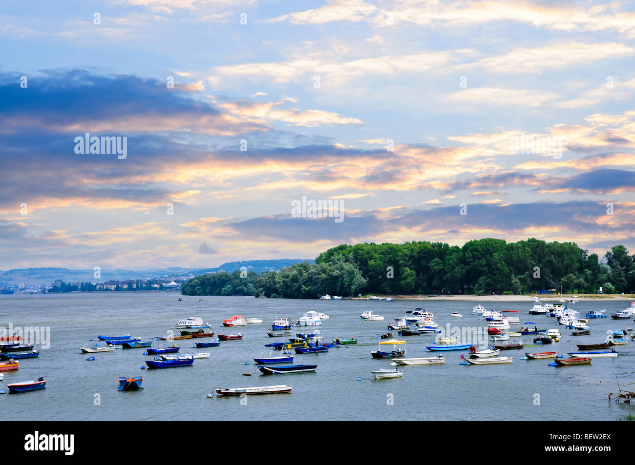 Many small fishing boats anchored on Danube river. View from Zemun part of Belgrade. - Stock Image
