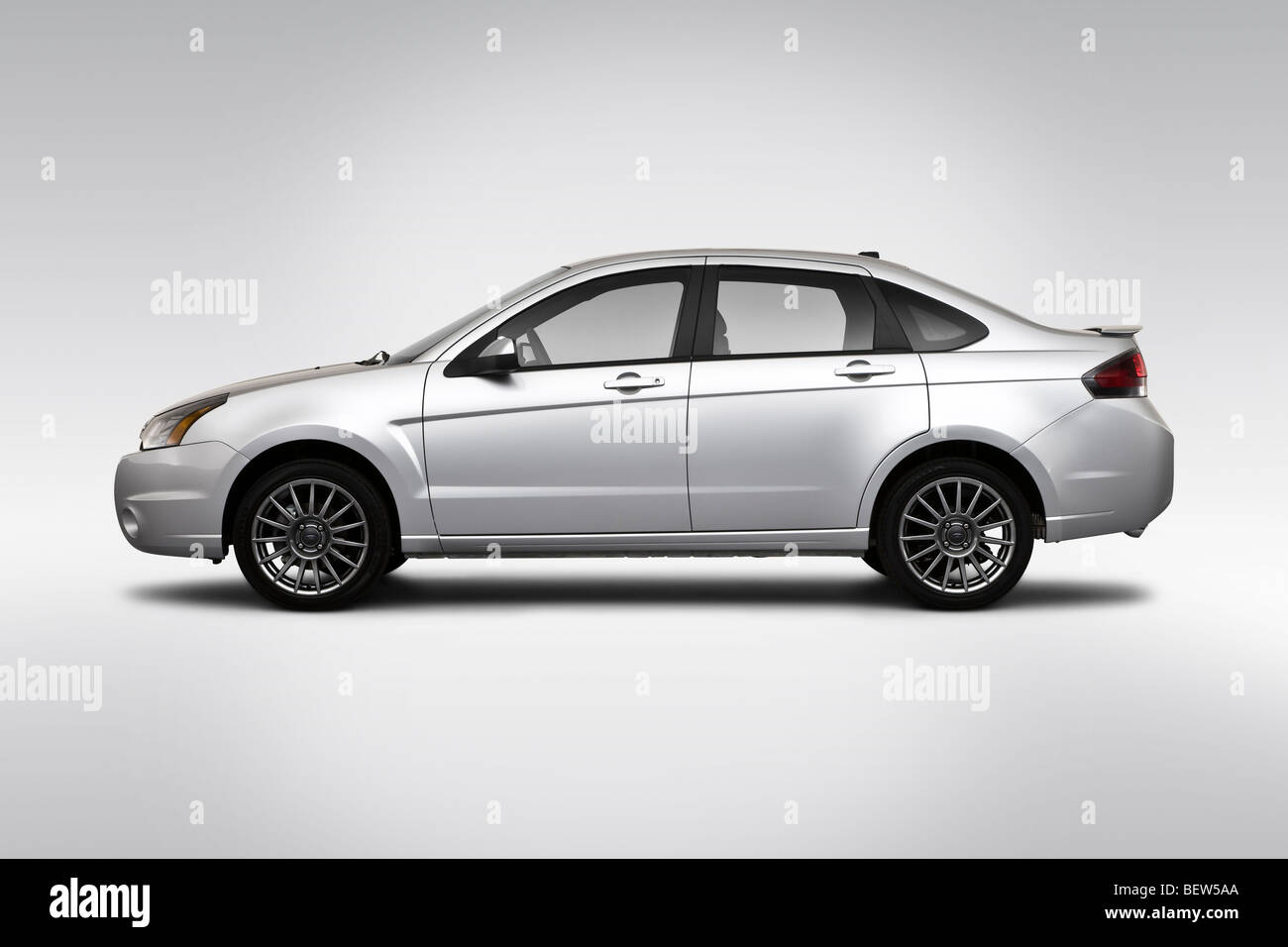 2010 Ford Focus SES in Silver - Drivers Side Profile - Stock Image