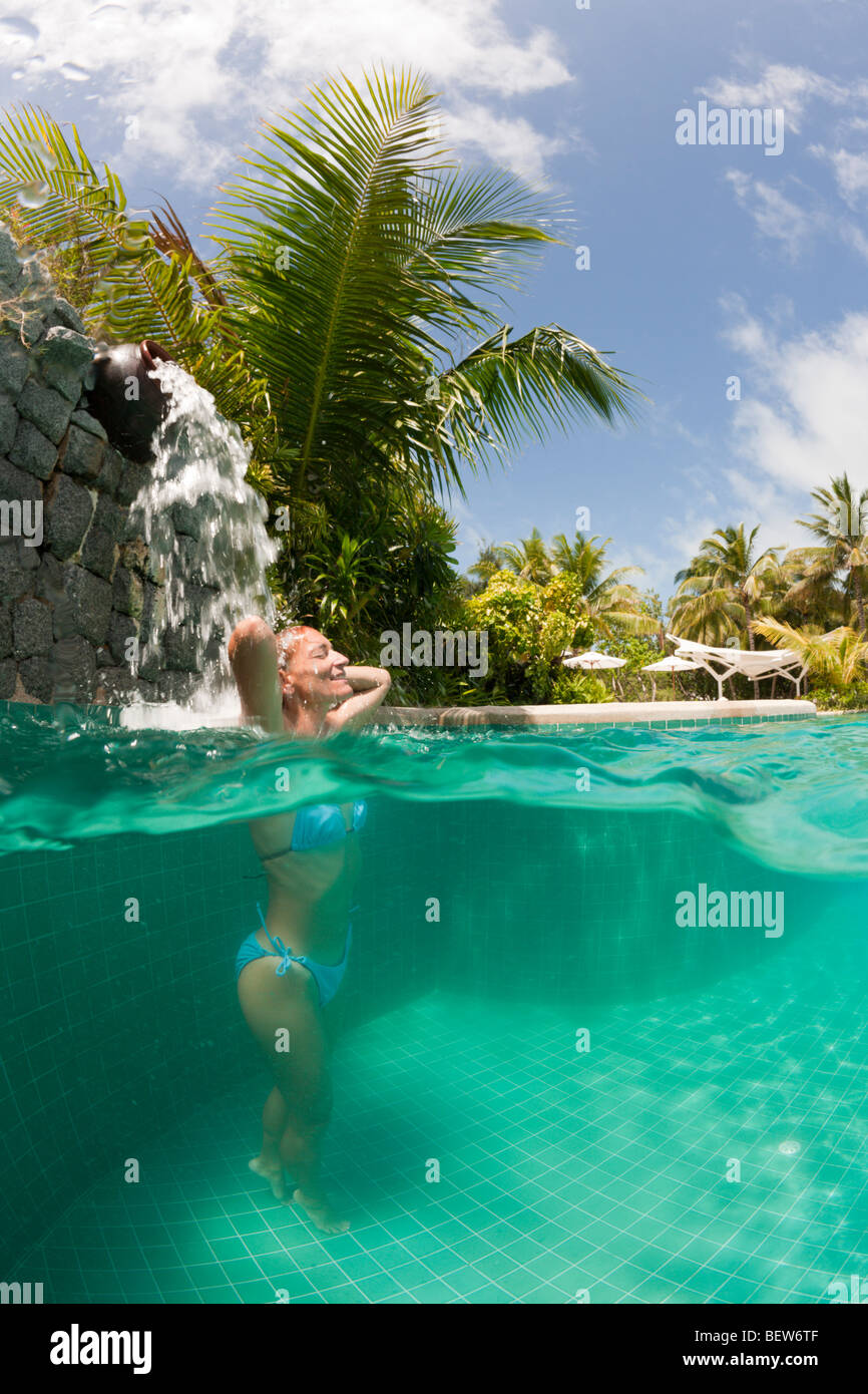 Woman in Swimming Pool, South Male Atoll, Maldives Stock Photo