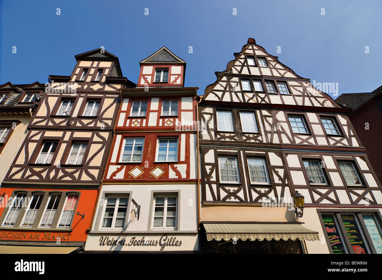 Half-timber houses at the market square of Cochem, Rhineland-Palatinate, Germany, low angle view - Stock Image