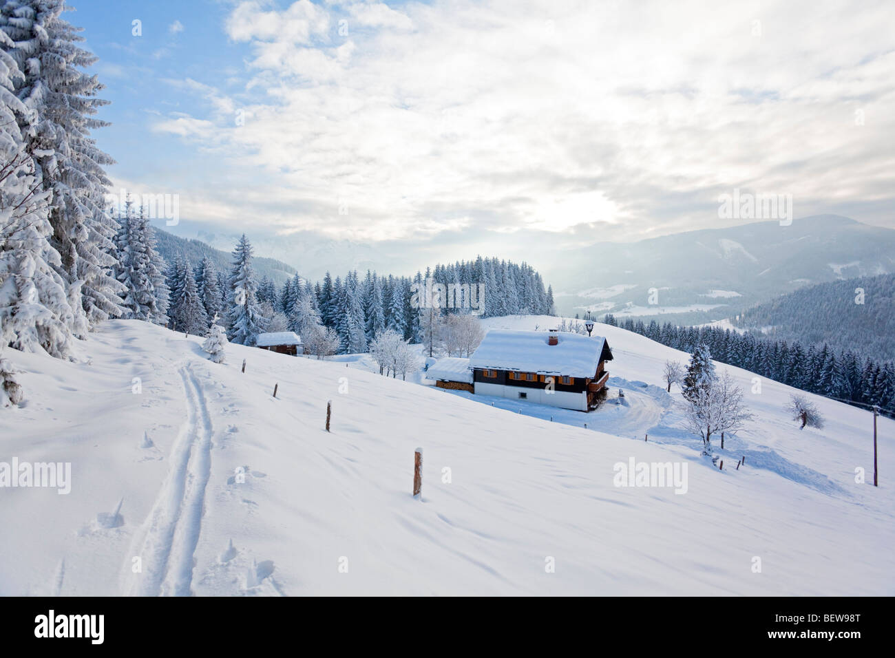 Alpine cabin on a snow-covered clearing, Annaberg-Lungoetz, Salzburger Land, Austria Stock Photo