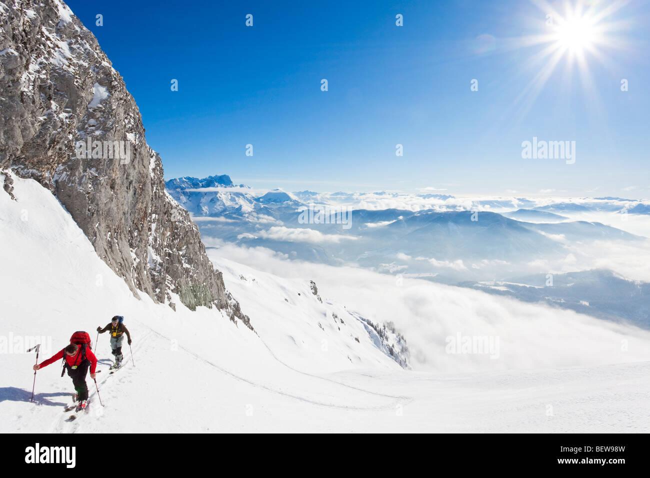 two men ski touring in the mountains, Salzburg, Austria, high angle view - Stock Image
