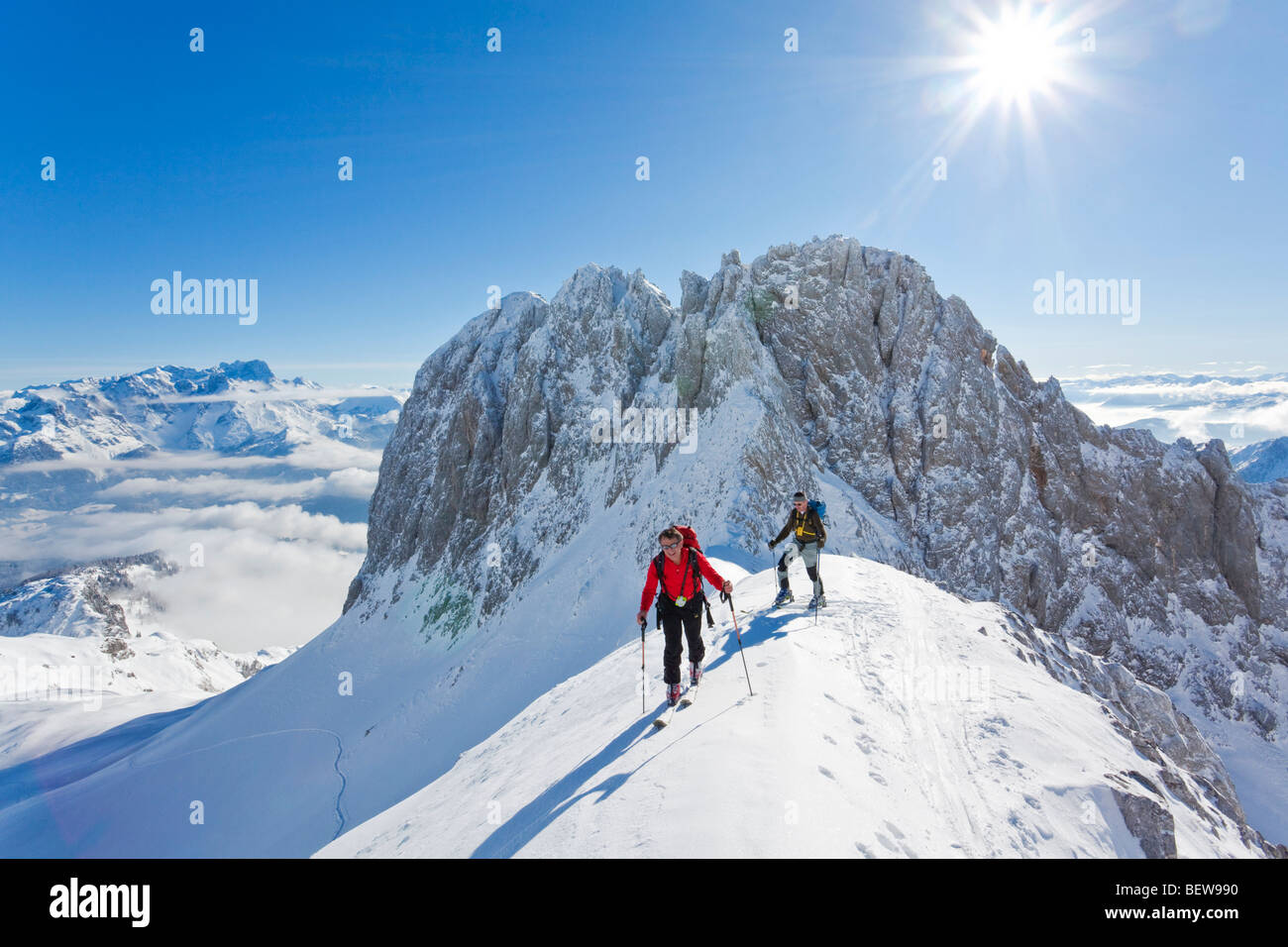 two men ski touring in the mountains, Salzburg, Austria - Stock Image