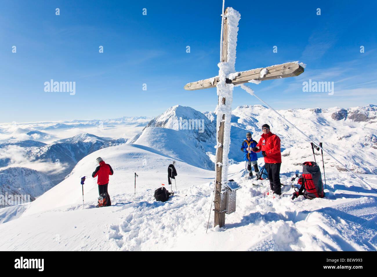 Three climber on a mountaintop, Salzburger Land, Austria Stock Photo