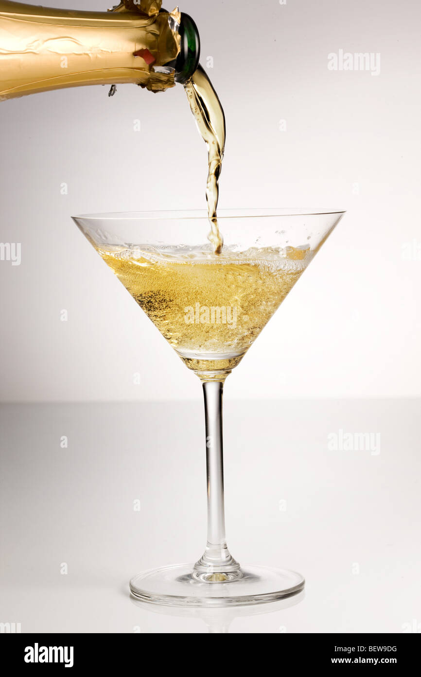 pouring champagne into a glass, close-up - Stock Image