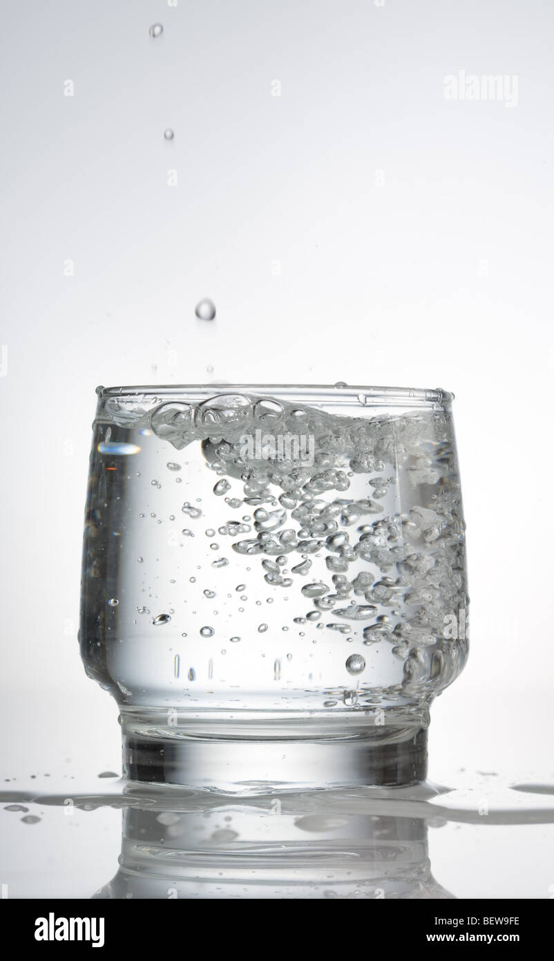 carbonated water in a glass, close-up - Stock Image
