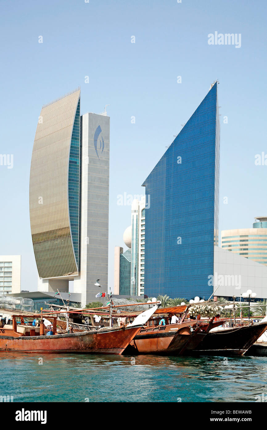 Traditional sailing vessels in front of Dubai skyline, United Arab Emirates - Stock Image