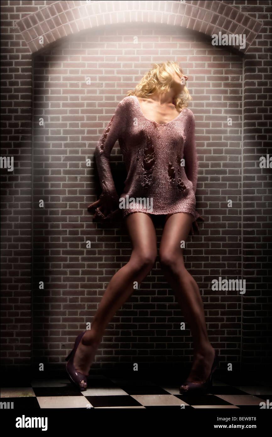 blonde woman posing, full shot - Stock Image