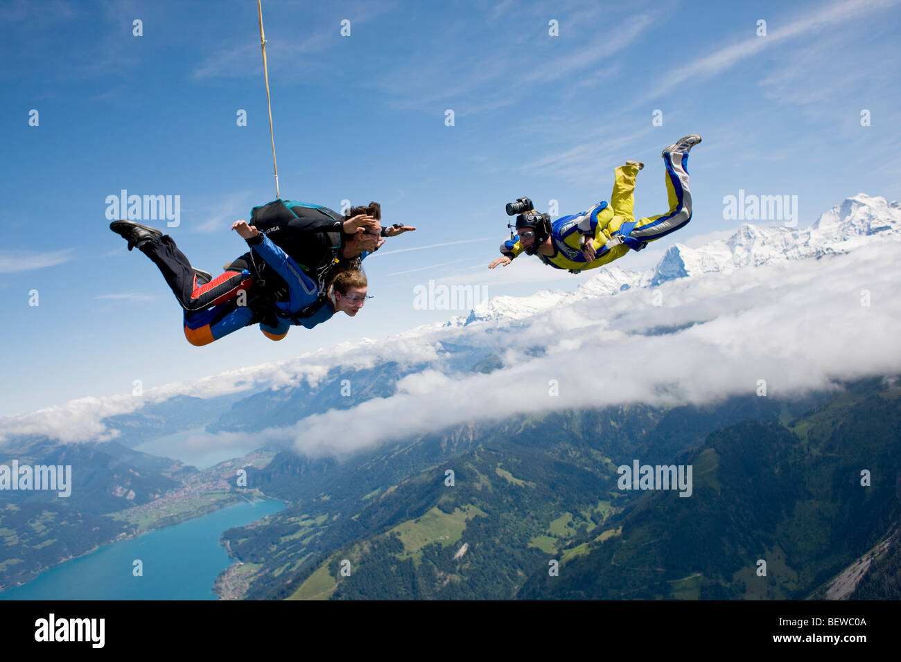 two people doing parachute jumping, full shot - Stock Image