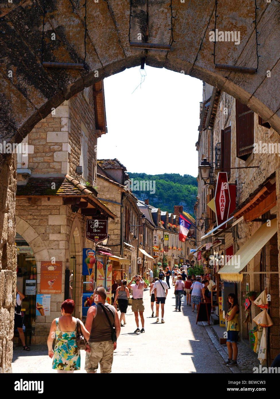 Shops along a lively alley in Rocamadour, Midi Pyrenees, France - Stock Image