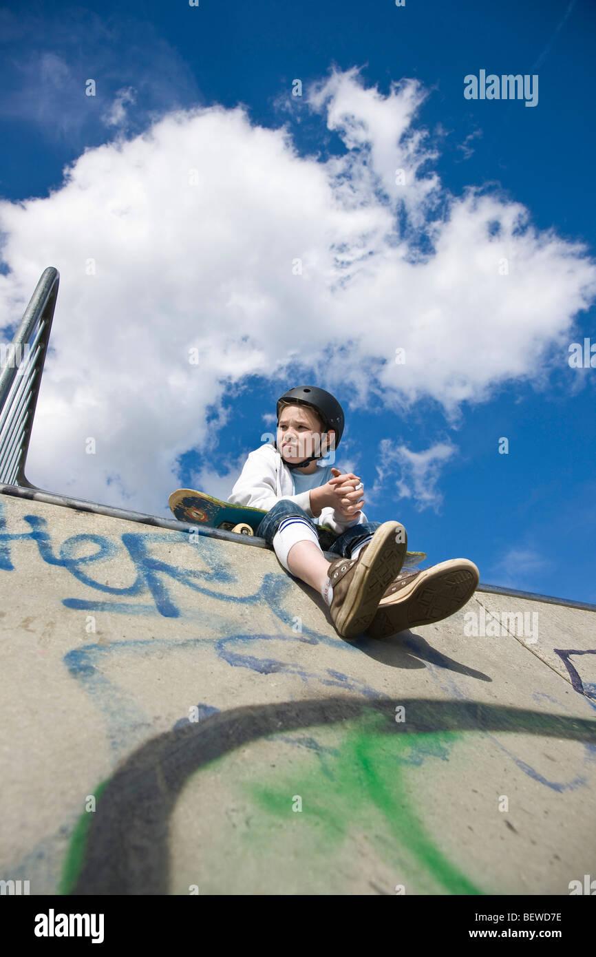 teenage skateboarder, view from below - Stock Image