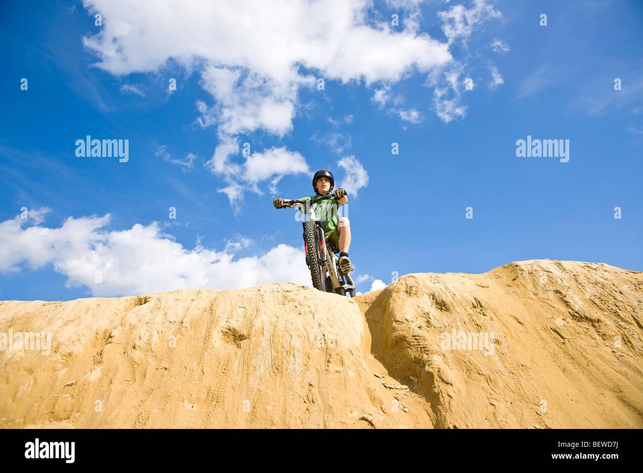 teenage mountain biker, view from below - Stock Image