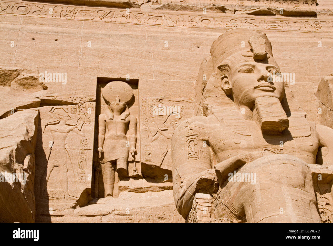 Colossal statue at the Temple of Ramesses II in Abu Simbel Egypt low angle view close-up Stock Photo