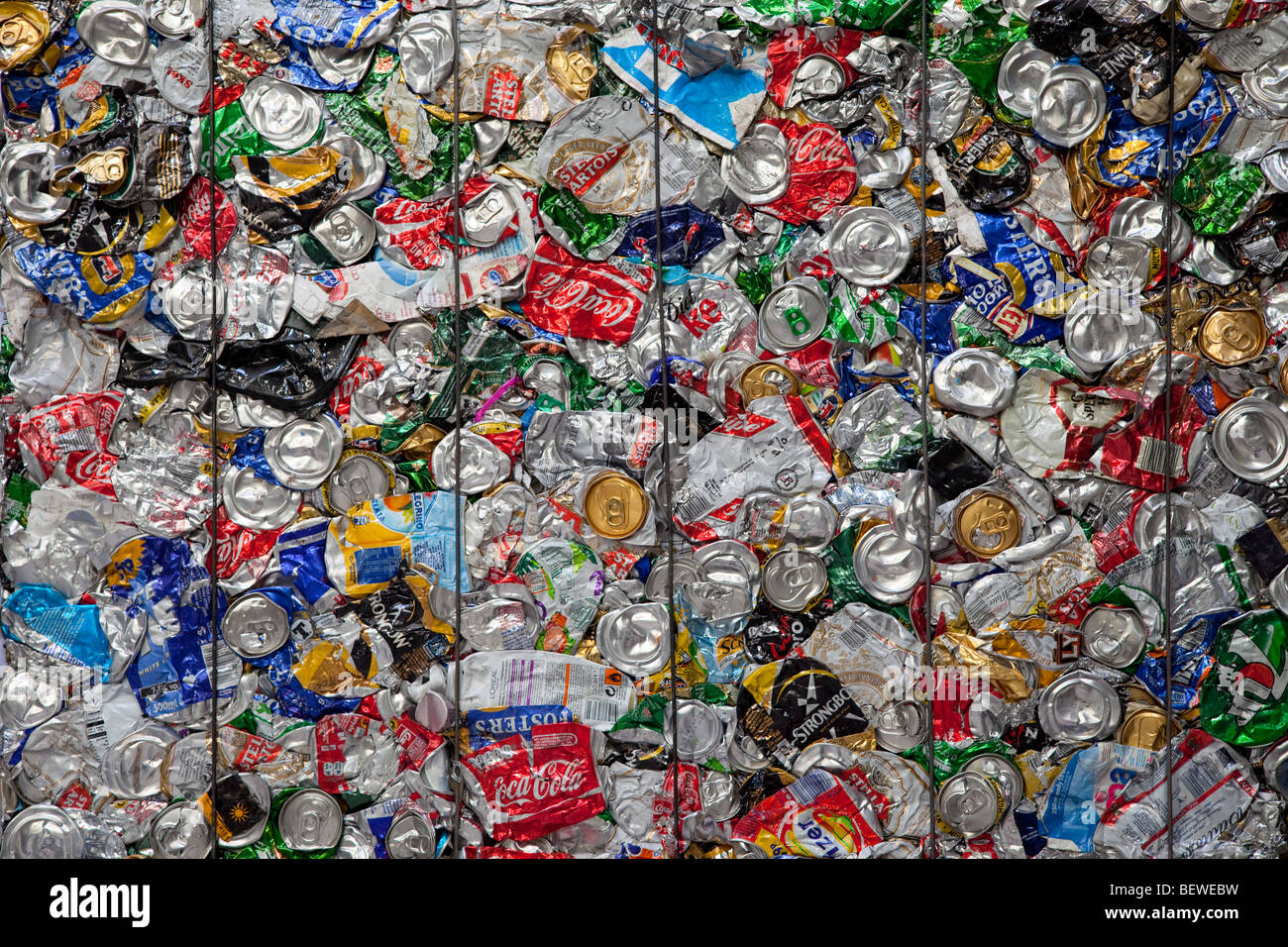 recycled aluminum drinks cans compressed into a block - Stock Image