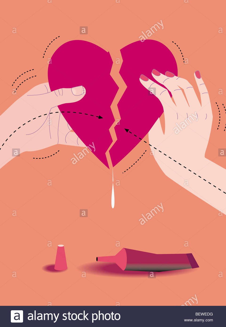 Man and woman gluing broken heart together - Stock Image