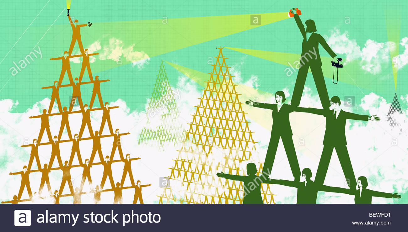 Businesspeople balancing on shoulders - Stock Image