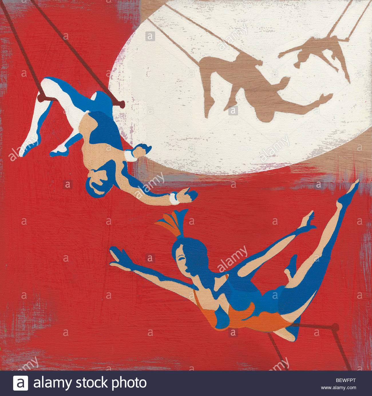 Trapeze artists swinging on trapeze - Stock Image