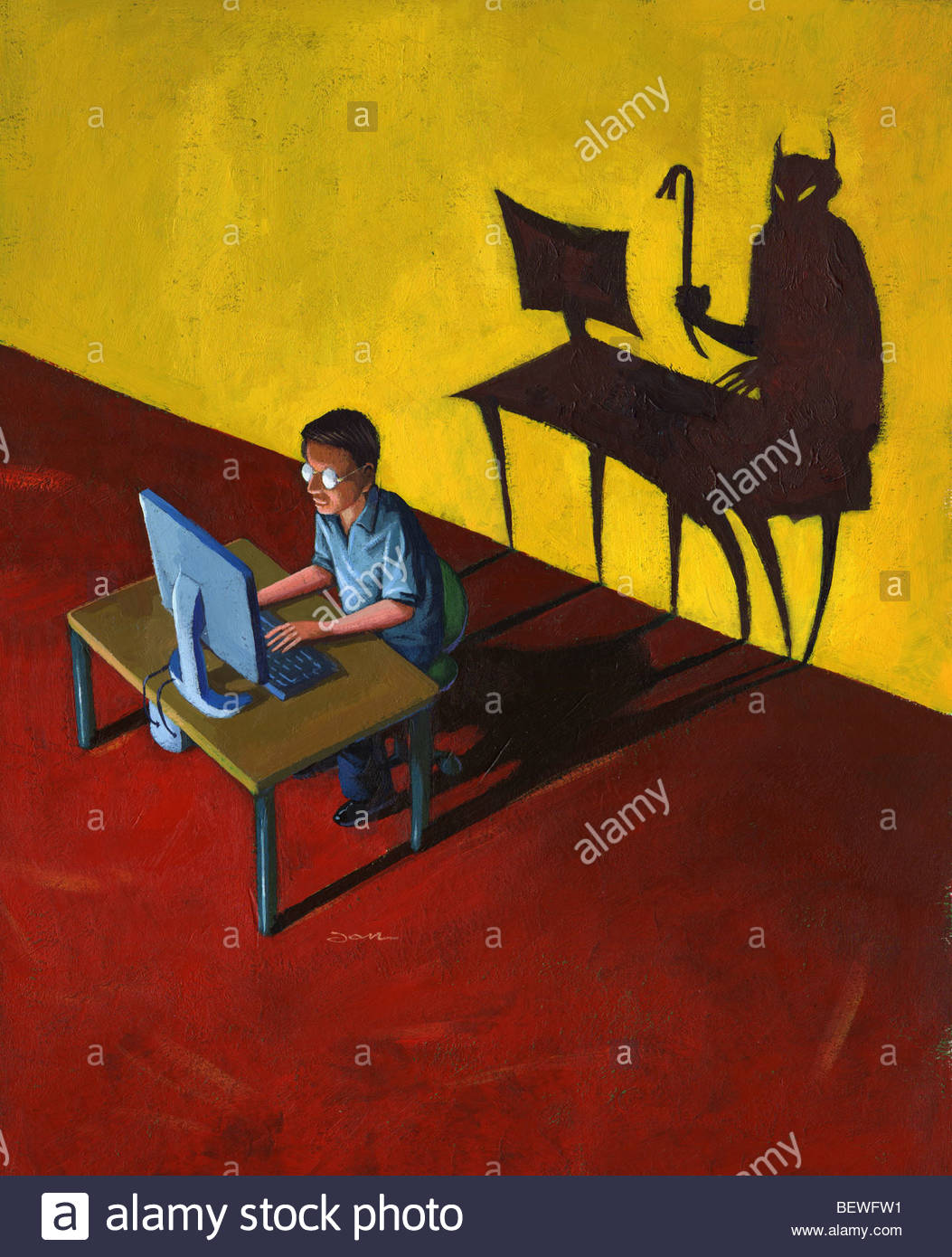 Devil lurking behind man on computer - Stock Image
