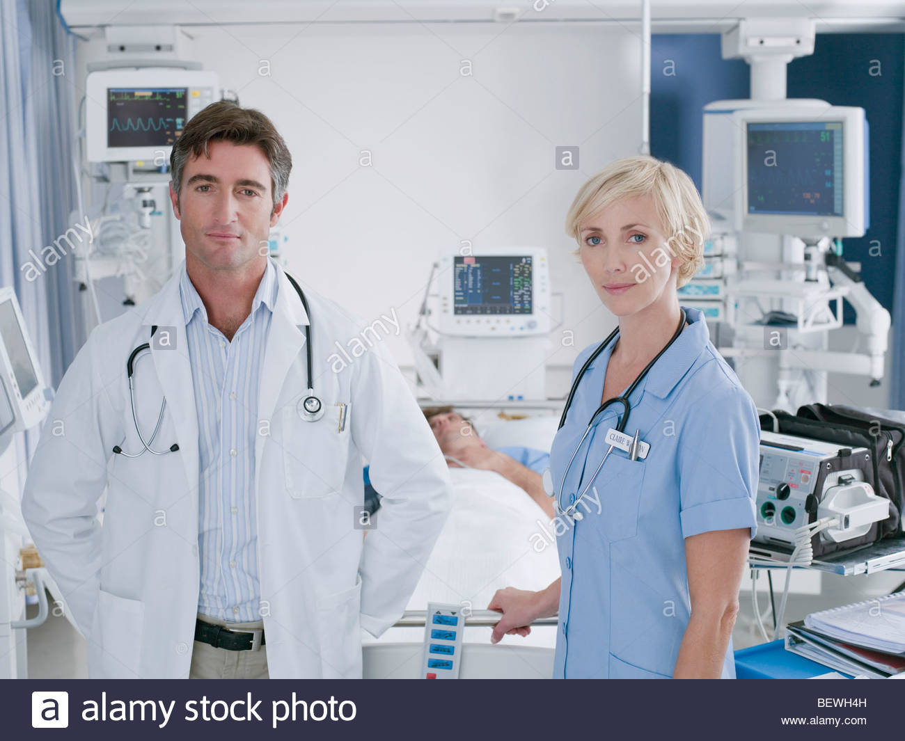 Doctor and nurse standing in intensive care Stock Photo