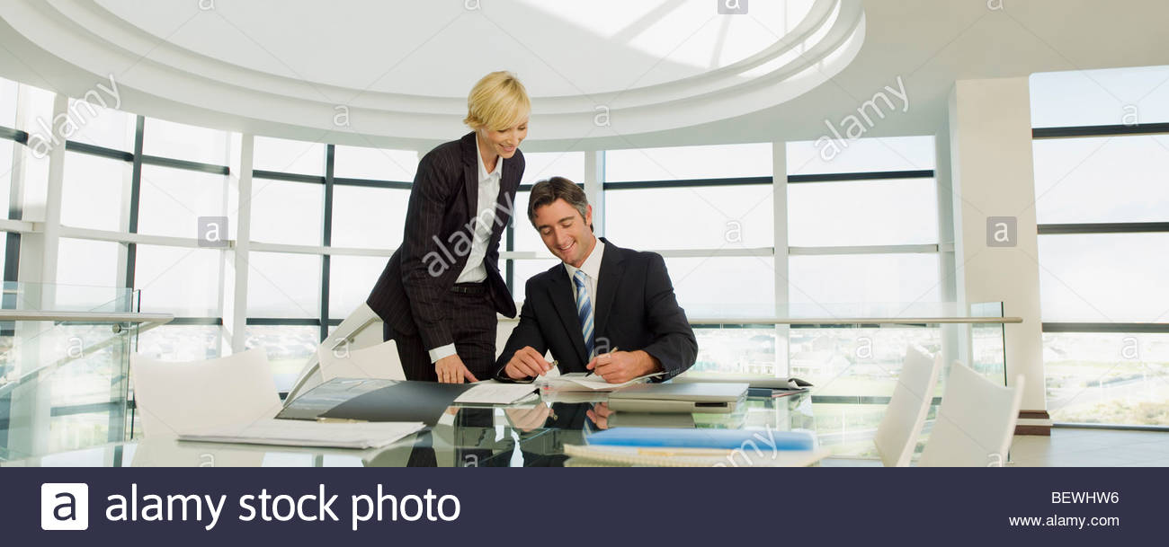 Business people working in modern office - Stock Image