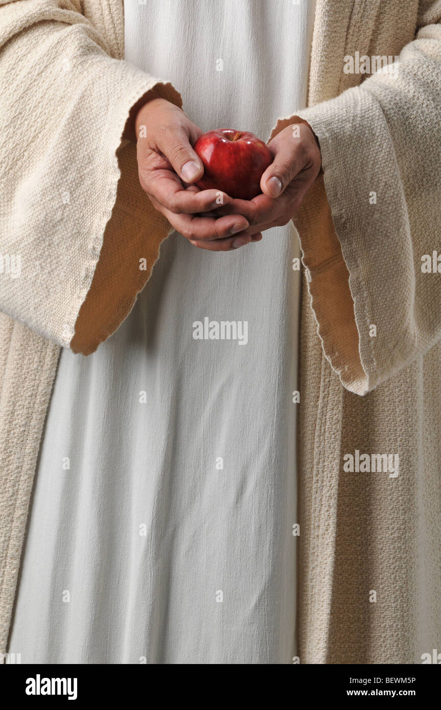Jesuss Hands Holding An Apple As A Symbol Of Producing Fruit Stock