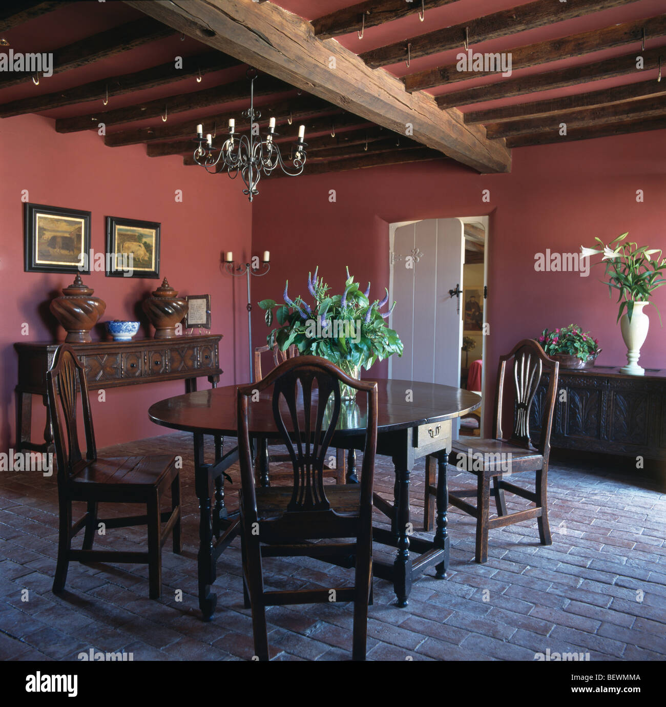 Antique Oak Table And Chairs In Red Country Dining Room With Brick Flooring Rustic Wooden Ceiling Beams