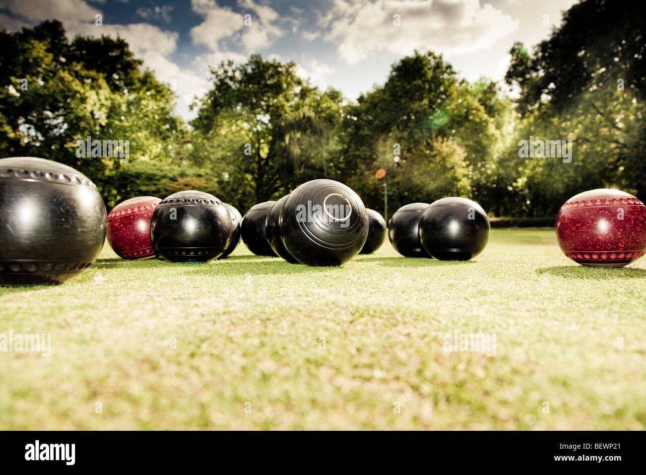 Low angle of a group of lawn bowls woods at Southwark Park Club - Stock Image