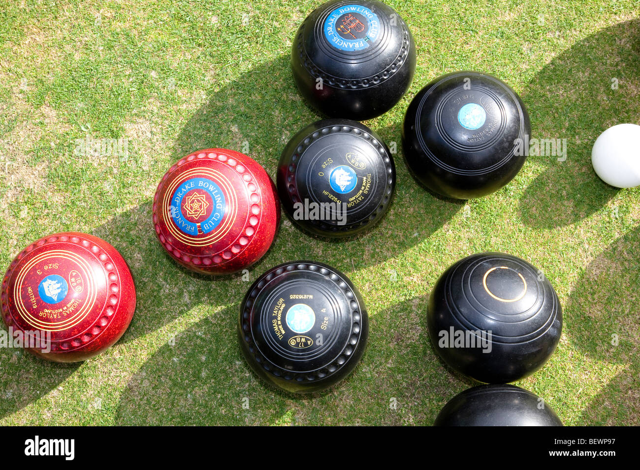 Overhead shot of a group of lawn bowls woods at Southwark Park Club - Stock Image