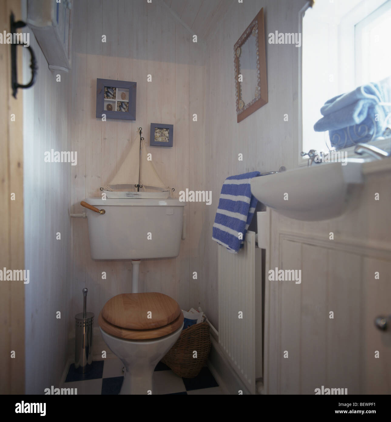 Model Sailing Boat On Toilet In Small White Seaside Themed